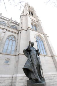 A statue of St. John Paul II stands outside the Cathedral Basilica of the Immaculate Conception downtown.