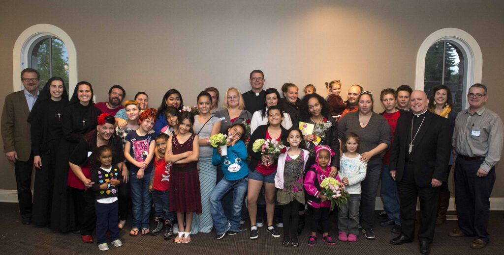 Mothers and families from Father Ed Judy House, a shelter for single mothers, were honored at a Mother's Day dinner hosted by Archbishop Samuel Aquila at the St. John Paul II Center May 10.