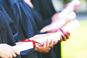 Graduates with diplomas.