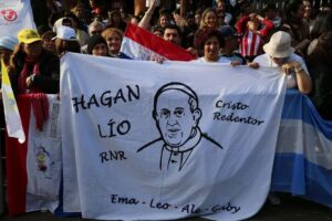 Women hold a banner with an image of Pope Francis in Caacupe, Paraguay during his visit July 11.