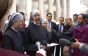 Sister Loraine Marie Maguire, Mother Provincial of the Little Sisters of the Poor, talks to media after the nuns' attorneys presented oral arguments in a case seeking exemption from a mandate to provide contraceptives, abortion-inducing drugs and sterilizations to employees.