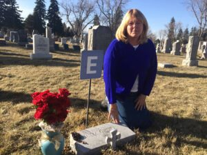 """California native Virginia Haddad joined the Julia Greeley bus tour Feb. 21 to learn more about a beloved family friend. In the only known photo of Denver's """"Angel of Charity,"""" Julia is holding Haddad's aunt, Marjorie Urquhart."""
