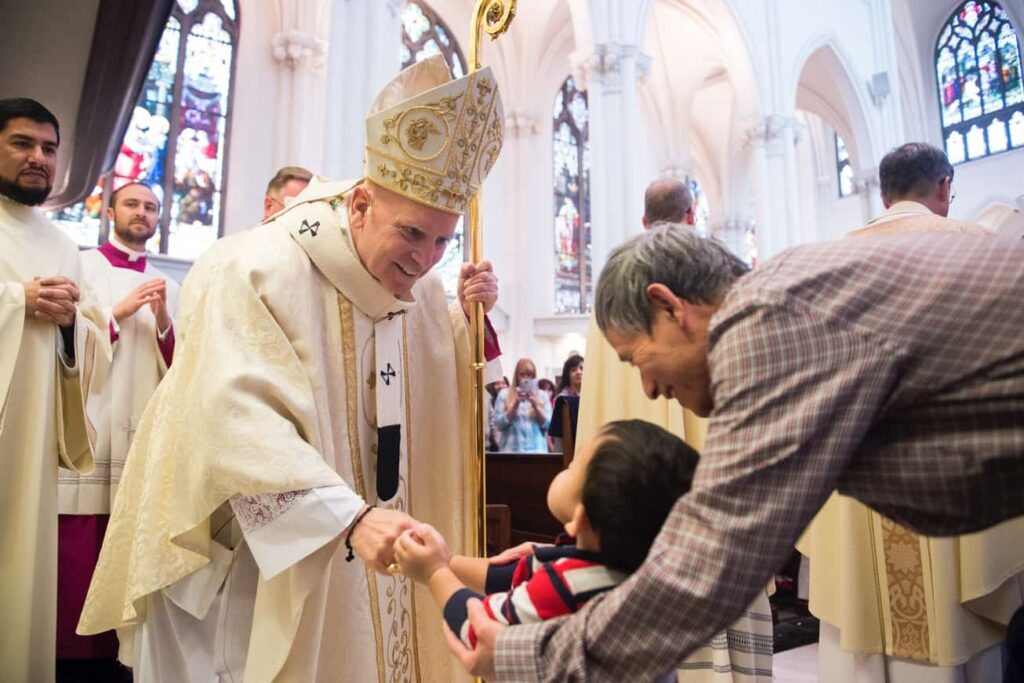 DENVER, CO, March 23, 2016 - Archbishop Samuel J. Aquila greets a young faithful during the Chrism Mass at the Cathedral Basilica of the Immaculate Conception. (Photo by Dan Petty/A&D Photography)