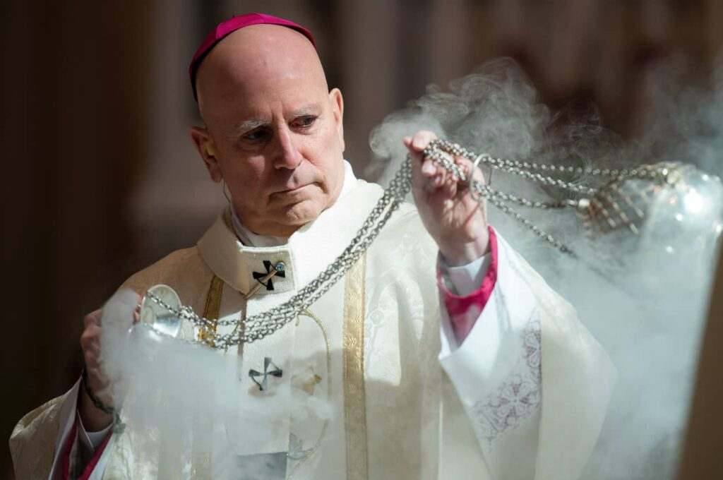 DENVER, CO, March 23, 2016 - Archbishop Samuel J. Aquila reverently blesses the holy oils with incense during the Chrism Mass. (Photo by Dan Petty/A&D Photography)