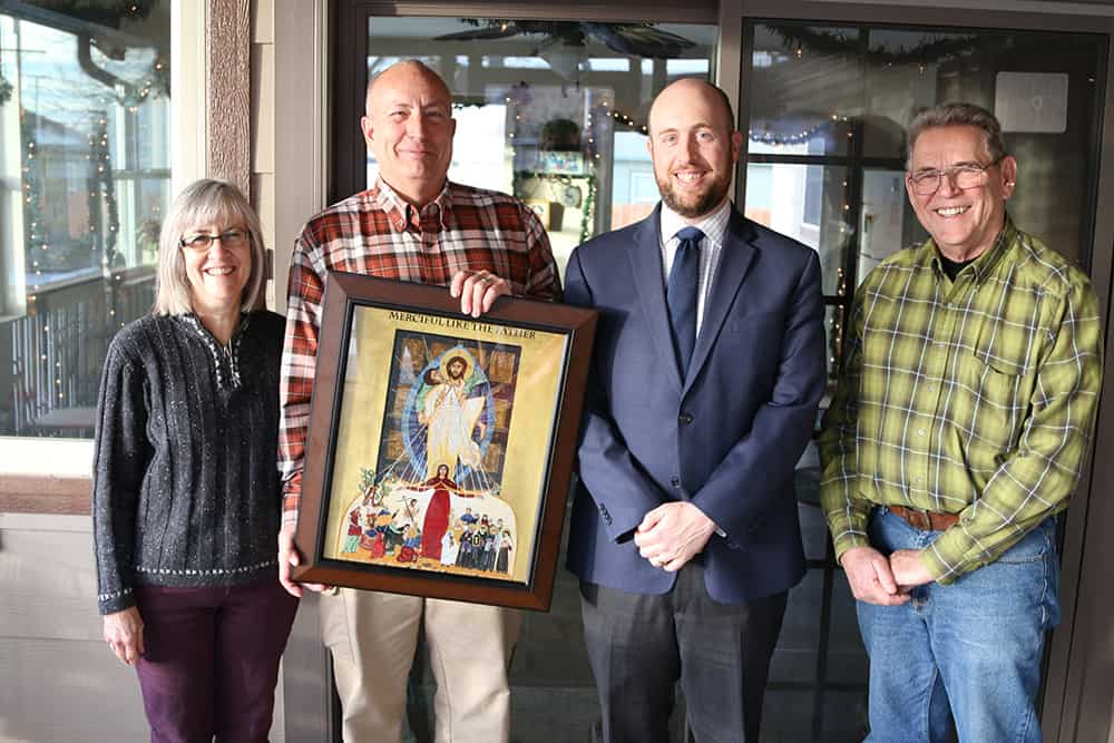 Mike Miller shows off his Year of Mercy icon with his wife Carol (Carol), Dave Uebbing (right), and Don Wolfe (far right). (Photo by Aaron Lambert)