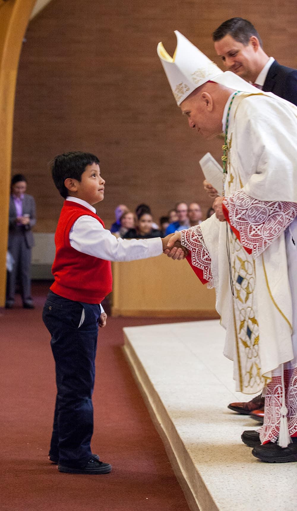 Archbishop Samuel J Aquila celebrates mass and visits the school, February 2, 2017: Sacred Heart of Jesus school Boulder, Colorado Photo by Andrew Wright/Denver Catholic