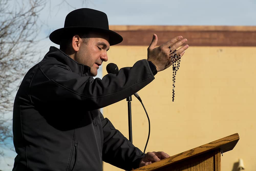 DENVER, CO - FEBRUARY 11: Fr. Andre Mahanna, pastor of St. Rafka Maronite Catholic Church, leads the crowd in prayer during the rally to defund Planned Parenthood across the street from Planned Parenthood of the Rocky Mountains on February 11, 2017, in Denver, Colorado. (Photo by Anya Semenoff/Denver Catholic)