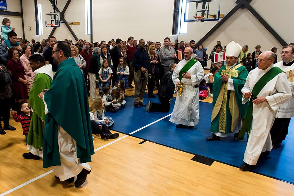 FOXFIELD, CO - JANUARY 29: Fr. David Bluejacket (L) and Denver Auxiliary Bishop Jorge Rodriguez (R) exit the new gymnasium after the dedication of the west wing of the St. Joseph Ministry Center and School Building at Our Lady of Loreto Catholic Parish and School on January 29, 2017, in Foxfield, Colorado. (Photo by Anya Semenoff/Denver Catholic)