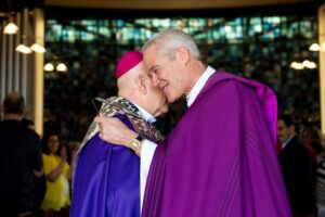 CHERRY HILLS VILLAGE, CO - MARCH 19: Denver Archbishop Samuel J. Aquila (L) and Bishop James Gonia (R) embrace following the Lutheran Catholic Common Commemoration of the Reformation at Bethany Lutheran Church on March 19, 2017, in Cherry Hills Village, Colorado. (Photo by Daniel Petty/for Denver Catholic)