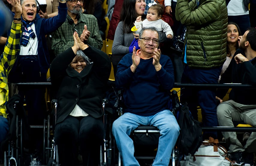 People from California cheer and a man cries after Way founder Kiko Arguello is introduced during a Neocatechumenal Way Gathering at the Coors Events Center on March 11 in Boulder. (Photo by Daniel Petty/for Denver Catholic)