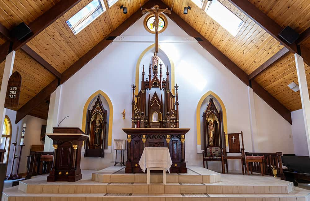 The altar at St. Scholastica was recently renovated and blessed by Archbishop Samuel J. Aquila. The Erie parish has served the community for over 120 years. (Photos by Brandon Young)